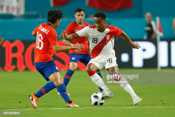 André Carrillo of Peru brings the ball upfield against Matias Fernandez of Chile during an International friendly match on October 12 2018 at Hard...
