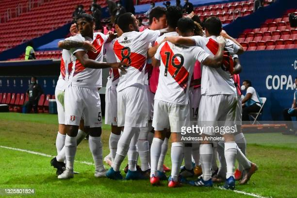 André Carrillo of Peru celebrates with teammates after scoring the opening goal during a Group B Match between Venezuela and Peru as part of Copa...