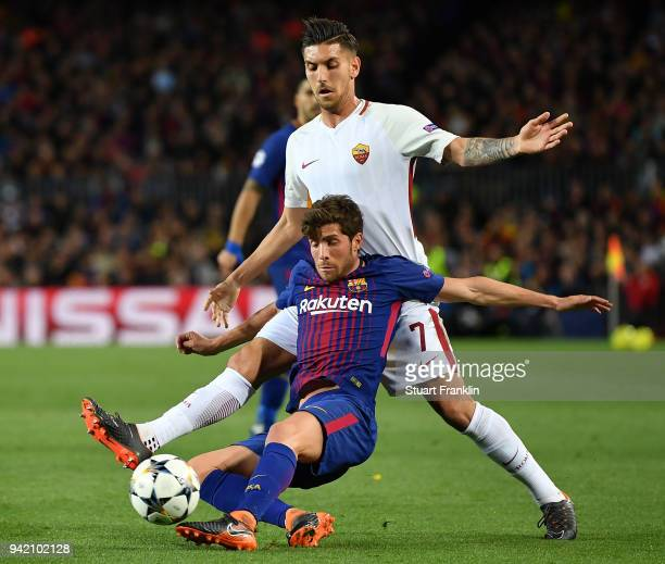 AndrŽ Gomes of Barcelona is challenged by Lorenzo Pellegrini of Roma during the quarter final first leg UEFA Champions League match between FC...