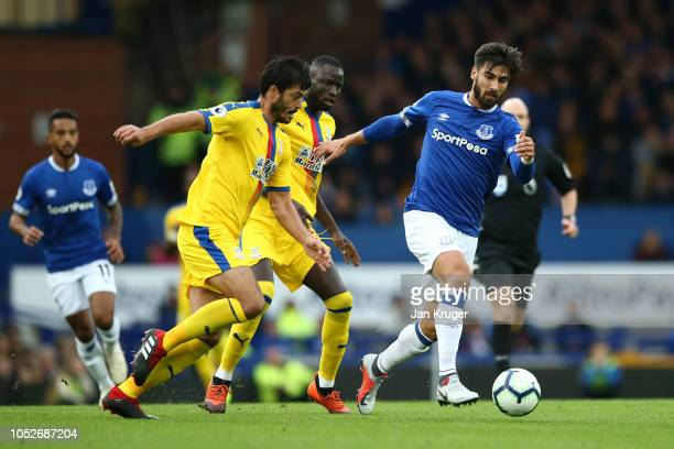 André Gomes of Everton is challanged by James Tomkins of Crystal Palace during the Premier League match between Everton FC and Crystal Palace at...