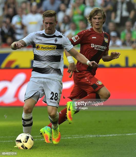 André Hahn of Moenchengladbach and Tin Jedvaj of Leverkusen battle for the ball during the Bundesliga match between Borussia Moenchengladbach and...