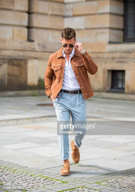 André Hellmundt is seen wearing brown jacket Topman white button shirt Olymp pants Suitsupply Vagabond shoes Longines watch on August 05 2019 in...