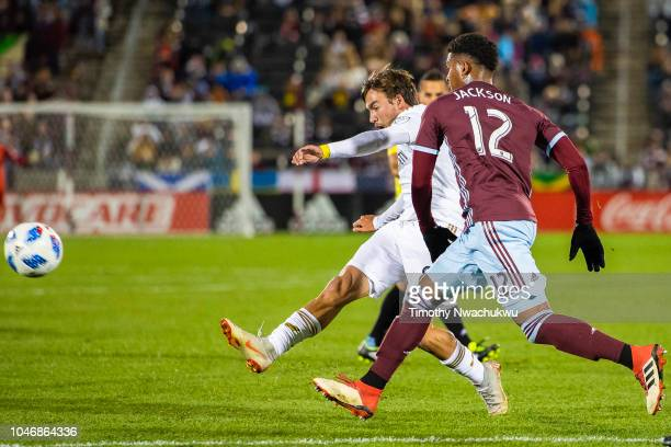 André Horta of Los Angeles FC attempts a shot past Niki Jackson of the Colorado Rapids during the second half at Dick's Sporting Goods Park on...