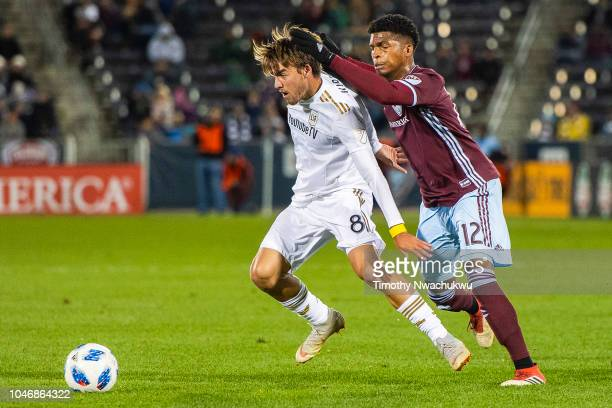 André Horta of Los Angeles FC dribbles past Niki Jackson of the Colorado Rapids during the second half at Dick's Sporting Goods Park on October 6...