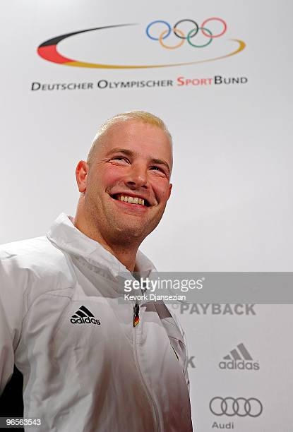 André Lange reacts after a news conference to announce he is the flag bearer of the German Olympic team ahead of the Vancouver 2010 Winter Olympics...