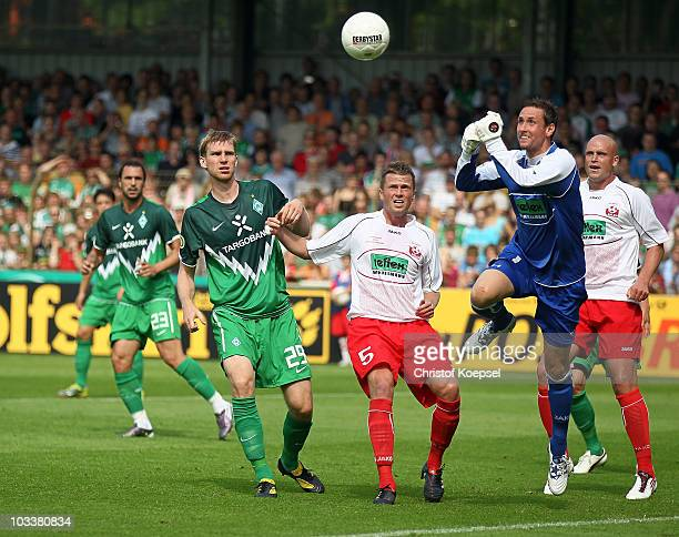 André Maczkowiak of Ahlen saves a ball against Per Mertesacker of Bremen during the DFB Cup first round match between Rot Weiss Ahlen and SV Werder...