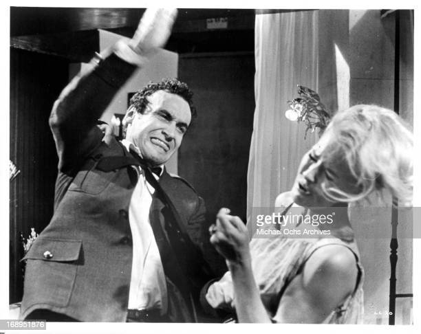 André Oumansky slaps Lola Albright in a scene from the film 'Joy House' 1964