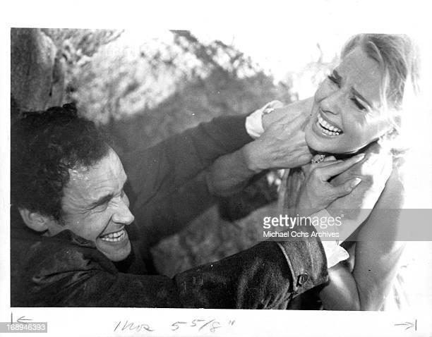André Oumansky strangles Lola Albright in a scene from the film 'Joy House' 1964