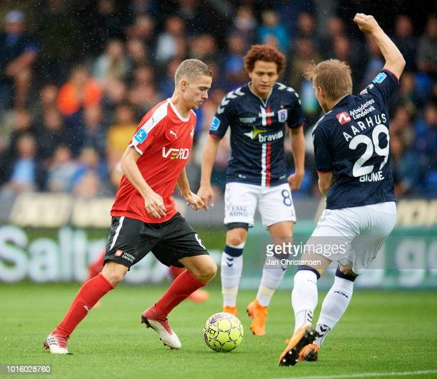 André Romer of Randers FC and Bror Blume of AGF Arhus compete for the ball during the Danish Superliga match between Randers FC and AGF Arhus at...