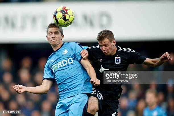 André Romer of Randers FC and Nicolai Poulsen of AGF Arhus heading the ball during the Danish 3F Superliga match between Randers FC and AGF Arhus at...