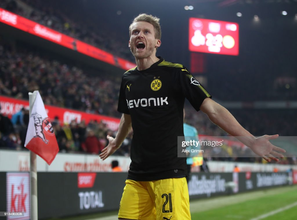AndrŽ SchŸrrle of Dortmund celebrates scoring his teams third goal during the Bundesliga match between 1. FC Koeln and Borussia Dortmund at RheinEnergieStadion on February 2, 2018 in Cologne, Germany.