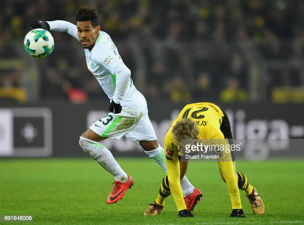 André Schürrle of Dortmund is challenged by Theodor Gebre Selassie of Bremen during the Bundesliga match between Borussia Dortmund and SV Werder...