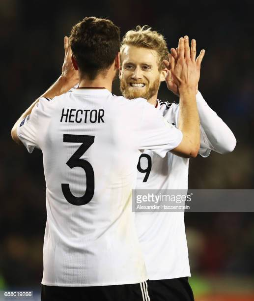 André Schürrle of Germany celebrates scoring the fourth goal with Jonas Hector during the FIFA 2018 World Cup Qualifiying group C match between...