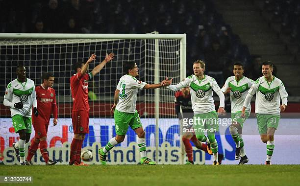 André Schürrle of Wolfsburg celebrates scoring his second goal during the Bundesliga match between Hannover 96 and VfL Wolfsburg at HDIArena on March...