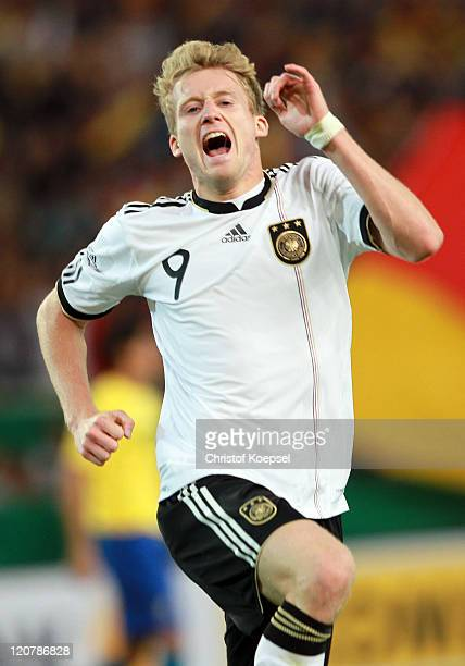 André Schuerrle of Germany celebrates the third goal during the International Friendly match between Germany and Brazil at MercedesBenz Arena on...