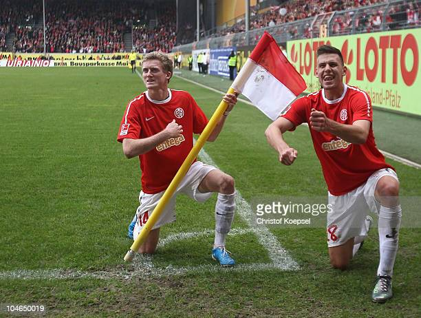 André Schuerrle of Mainz celebrates the fourth goal with Ádám Szalai of Mainz during the Bundesliga match between FSV Mainz 05 and 1899 Hoffenheim at...
