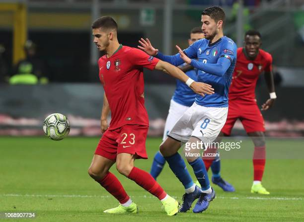 André Silva is challenged by ita8 of Italy during the UEFA Nations League A group three match between Italy and Portugal at Stadio Giuseppe Meazza on...