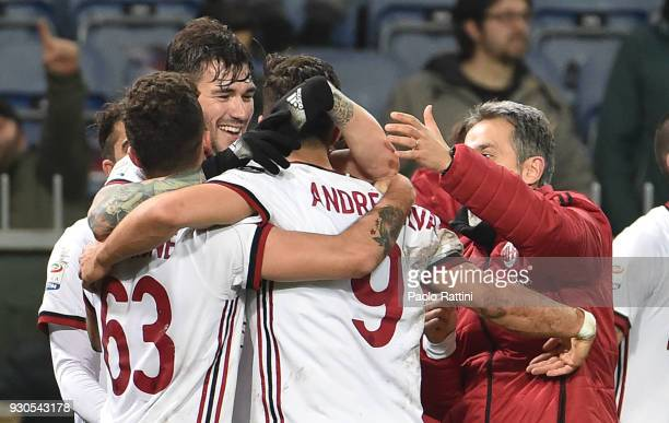 Andr Silva of AC Milan celebrates with teammates after scoring 01 during the serie A match between Genoa CFC and AC Milan at Stadio Luigi Ferraris...