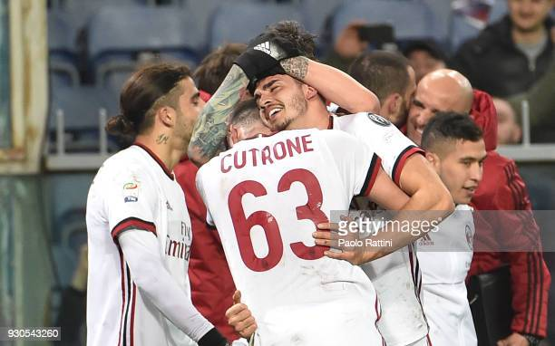 Andr Silva of Milan celebrate after his goal 01 during the serie A match between Genoa CFC and AC Milan at Stadio Luigi Ferraris on March 11 2018 in...