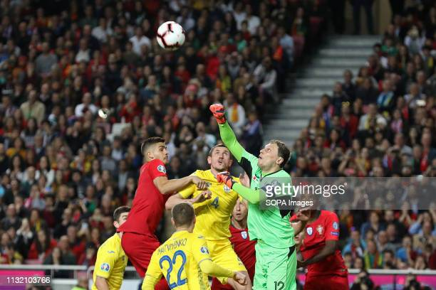 LUZ STADIUM LISBON PORTUGAL André Silva of Portugal vies for the ball with Sergii Kryvtsov of Ukraine and Andriy Pyatov of Ukraine during the...