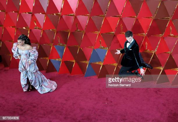 Andra Day and Ansel Elgort attend the 90th Annual Academy Awards at Hollywood Highland Center on March 4 2018 in Hollywood California