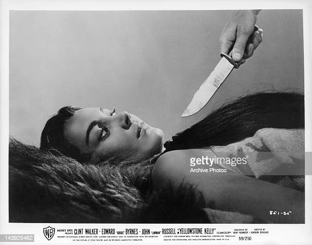 Andra Martin has knife drawn on her in a scene from the film 'Yellowstone Kelly' 1959