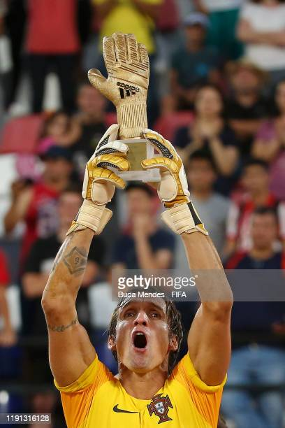 Andrade of Portugal celebrates after being presented with the Golden Glove trophy following his team's victory in the final match against Italy at...