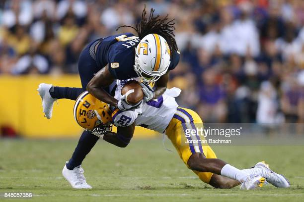 Andraez Williams of the LSU Tigers tackles Alphonso Stewart of the Chattanooga Mocs during the first half of a game at Tiger Stadium on September 9...