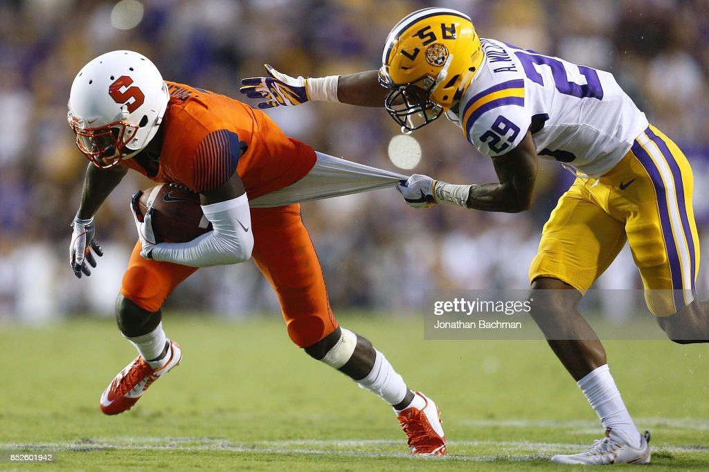 Andraez Williams #29 of the LSU Tigers tackles Ervin Philips #3 of the Syracuse Orange during the first half of a game at Tiger Stadium on September 23, 2017 in Baton Rouge, Louisiana.
