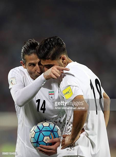 Andranik Teymourian and Alireza Jahanbakhsh of iran looks on during FIFA 2018 World Cup Qualifier match between Iran against Qatar on September 1...