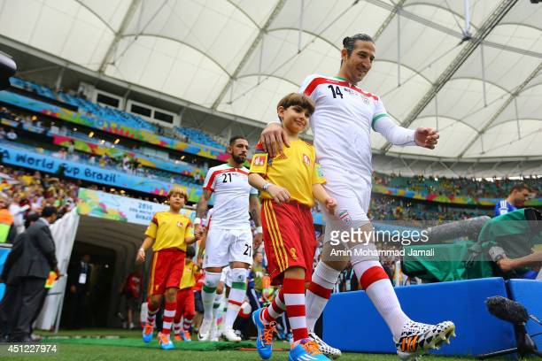 Andranik Teymourian and Ashkan Dejagah of Iran react after the 2014 FIFA World Cup Brazil Group F match between Bosnia and Herzegovina and Iran at...