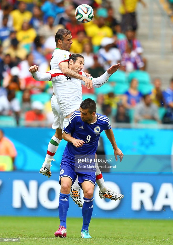 Andranik Teymourian and Jalal Hosseini of Iran and Vedad Ibisevic of Bosnia in action during the 2014 FIFA World Cup Brazil Group F match between Bosnia and Herzegovina and Iran at Arena Fonte Nova on June 25, 2014 in Salvador, Brazil.