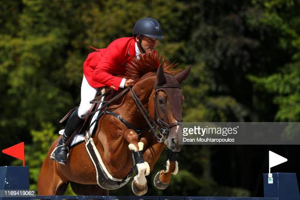 Andras Kovy jun of Hungary riding Heureka 22 competes during Day 3 of the Longines FEI Jumping European Championship speed competition against the...