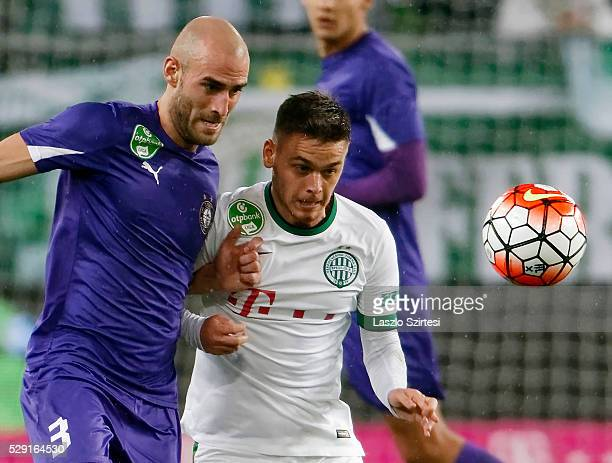 Andras Rado of Ferencvarosi TC duels for the ball with Jonathan Heris of Ujpest FC during the OTP Bank League football match between Ferencvarosi TC...