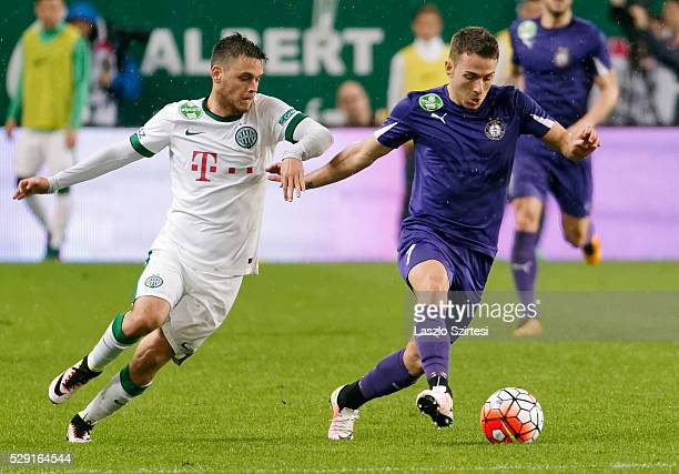 Andras Rado of Ferencvarosi TC is overtaken by Kylian Hazard of Ujpest FC during the OTP Bank League football match between Ferencvarosi TC and...