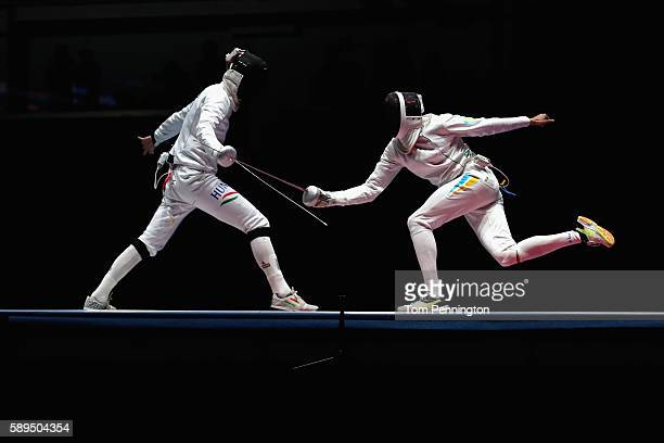 Andras Redli of Hungary competes against Anatolii Herey of Ukraine during the Men's Epee Team Bronze Medal Match on Day 9 of the Rio 2016 Olympic...