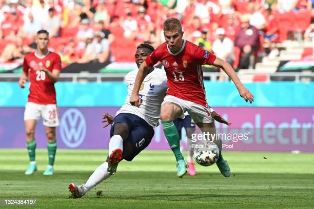 Andras Schaefer of Hungary is challenged by Paul Pogba of France during the UEFA Euro 2020 Championship Group F match between Hungary and France at...