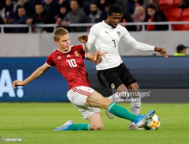 Andras Schafer of Hungary U21 challenges Kelvin Arase of Austria U21 during the International Friendly match between Hungary U21 and Austria U21 at...