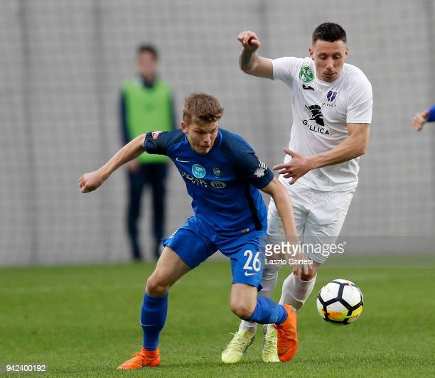 Andras Schafer of MTK Budapest competes for the ball with Branko Pauljevic of Ujpest FC during the Hungarian Cup Quarter Final 2nd Leg match between...