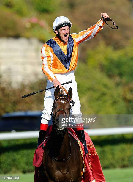 Andrasch Starke riding Danedream celebrates after winning the Qatar Prix De L'Arc De Triomphe at Longchamp racecourse on October 02 2011 in Paris...