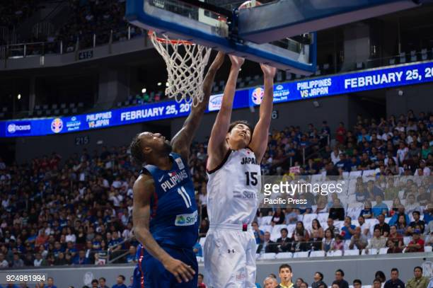 Andray Blatche of Gilas Pilipinas blocked the shot of J Takeuchi of Akatsuki Japan