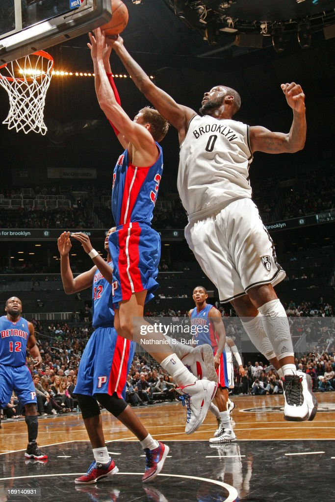Andray Blatche #0 of the Brooklyn Nets blocks a shot against Jonas Jerebko #33 of the Detroit Pistons on April 17, 2013 at the Barclays Center in the Brooklyn borough of New York City.