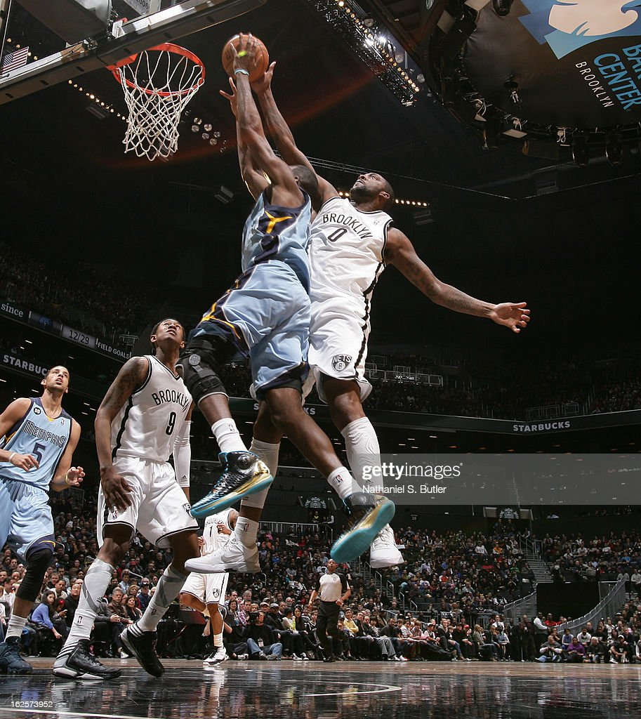 Andray Blatche #0 of the Brooklyn Nets blocks Mike Conley #11 of the Memphis Grizzlies on February 24, 2013 at the Barclays Center in the Brooklyn borough of New York City.