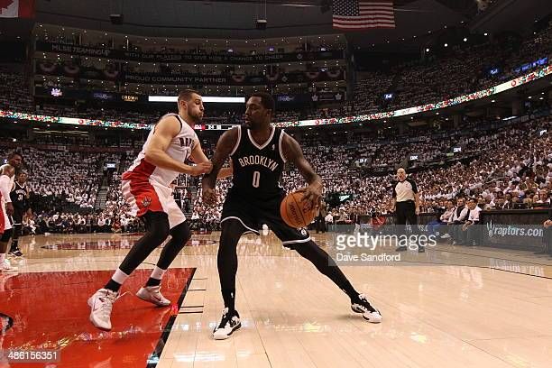 Andray Blatche of the Brooklyn Nets drives against the Toronto Raptors in Game Two of the Eastern Conference Quarterfinals during the NBA Playoffs at...