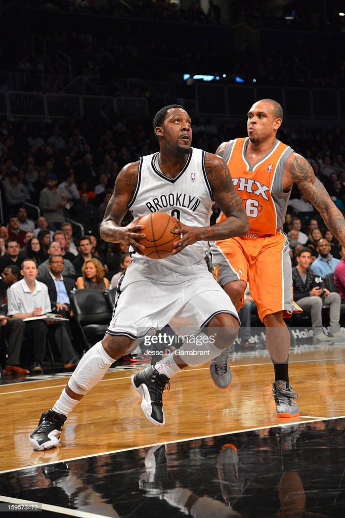 Andray Blatche #0 of the Brooklyn Nets drives to the basket against the Phoenix Suns at the Barclays Center on January 11, 2013 in Brooklyn, New York.