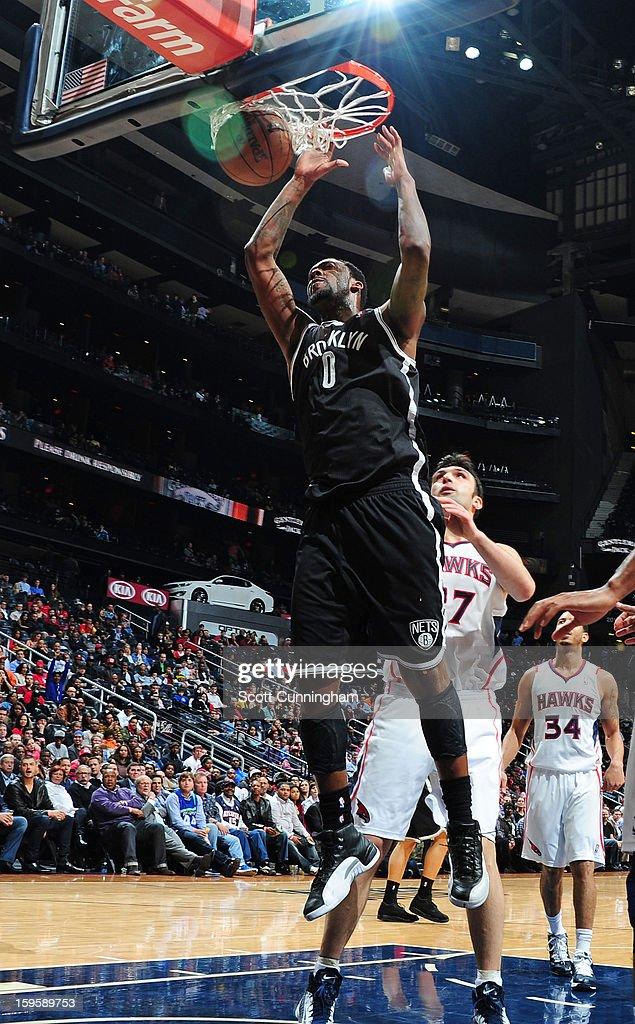 Andray Blatche #0 of the Brooklyn Nets dunks against the Atlanta Hawks on January 16, 2013 at Philips Arena in Atlanta, Georgia.