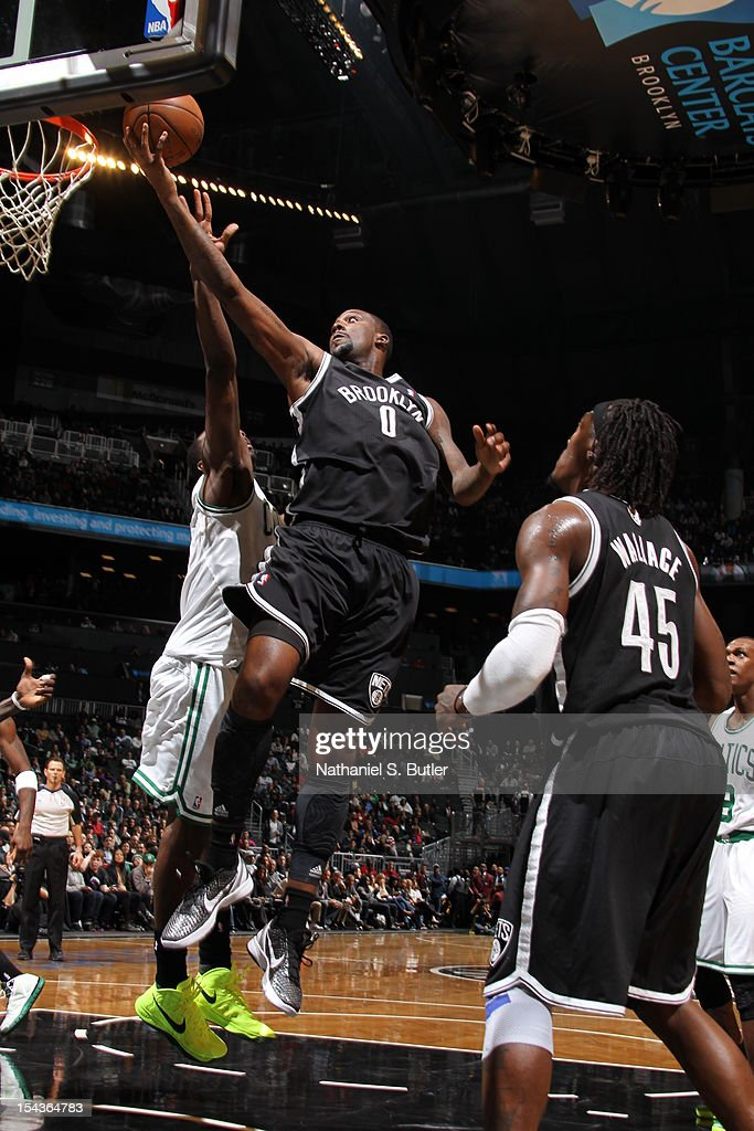 Andray Blatche #0 of the Brooklyn Nets goes to the basket against Jeff Green #8 of the Boston Celtics during a pre-season game on October 18, 2012 at the Barclays Center in the Brooklyn borough of New York City.