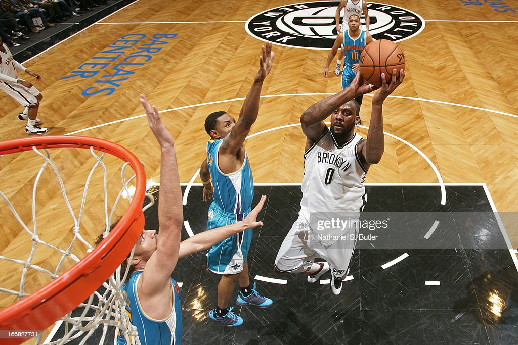Andray Blatche #0 of the Brooklyn Nets shoots against Roger Mason Jr. #8 of the New Orleans Hornets on March 12, 2013 at the Barclays Center in the Brooklyn borough of New York City.