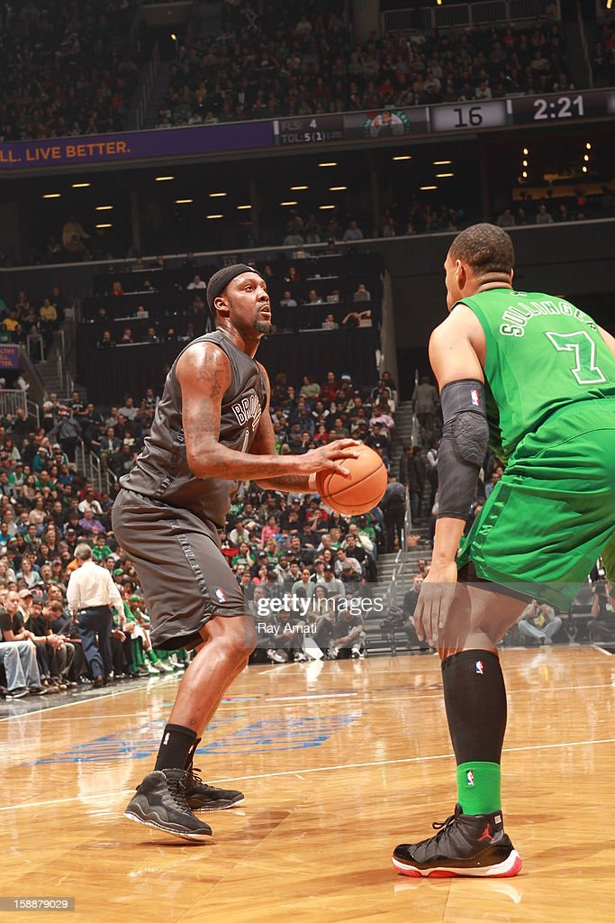 Andray Blatche #0 of the Brooklyn Nets shoots against the Boston Celtics on December 25, 2012 at the Barclays Center in Brooklyn, New York.