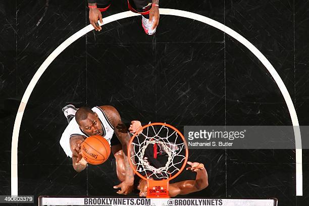Andray Blatche of the Brooklyn Nets shoots against the Miami Heat during Game Three of the Eastern Conference Semifinals on May 10 2014 at Barclays...